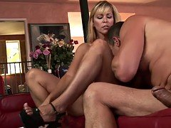 Blonde cougar knows how to satisfy a younger man
