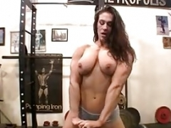 Naked Woman Bodybuilder Poses in the Gym