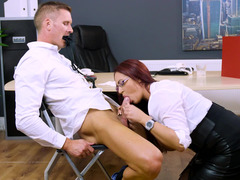 Sexy boss in black leather makes an employee fuck her
