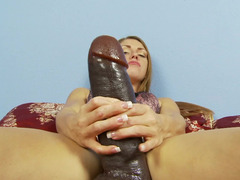 A sexy thing is pushing a large dildo into her beefy and moreover sexy muff