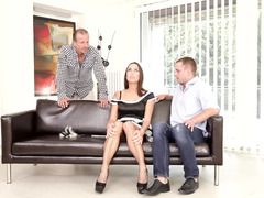 A hot maid is getting her fuck hole rammed on the sofa by two guys