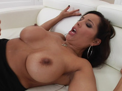 A boobalicious milf is getting her muff spread open by a huge cum cannon