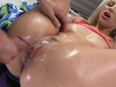 Oiled up slightly fat blonde whore Ashley Fires getting her holes drilled