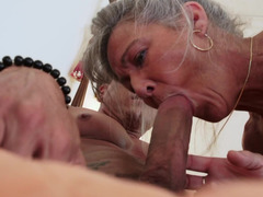 An aged female is getting fucked really hard on the bed here