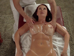 A redhead is covered with oil and besides she is then fucked hard