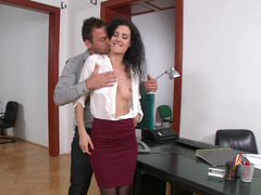A black haired broad with a little rack is getting fucked in the office