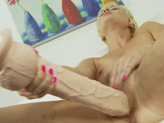 A blonde that likes her toys is using a gigantic dildo on her pink slit