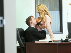 A blonde with sizable jugs is giving a blow job in the office