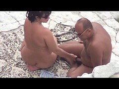 Mature nymph does dt stud and has sex on a public beach