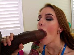 A hot little white chick receives a big hard black cock