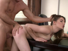 Brunette is getting penetrated in the office by the warden with a big dick