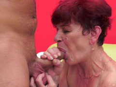 Fat granny with red short hair is getting fucked in her snatch