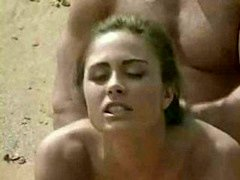 Brunette getting laid on beach