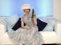 Grown-up housewife makes love a cucumber