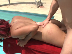 Redhead is getting a fuck pole shoved inside her by the pool outside