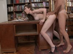A brunette that loves to fuck is rammed in the ass on the desk