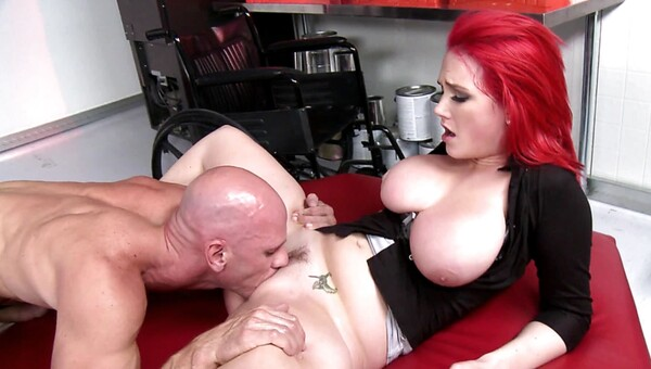 A redhead with huge tits is getting tit fucked on the bed