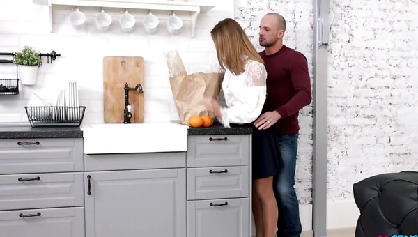 A lovely blonde girl is being fucked in the kitchen