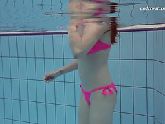 lovely lera takes her pink swimsuit in a swimming pool