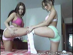 A duo hot lesbian twins perform sexual gymnastics on queen-size bed