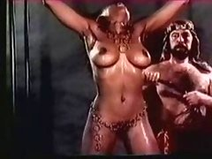 Large Titted Harem Menial Receives An Extreme Whipping (in slow motion)
