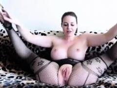 Hot dame wearing a black bodystocking plays