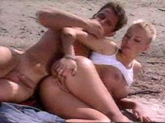 French couple having sex on the beach