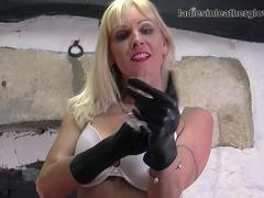 Blonde Milf strips off sexy white lingerie and fingers her wet pussy in leather gloves and boots