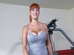 Bigtitted redhead doing sport