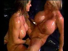 huge titted lesbos playing in oil