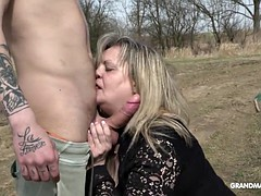 lustful lucky granma enjoying a young fat hard cock outdoors