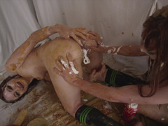 A couple of redhead lesbians have a food fetish and get covered with cream