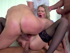 Four large guys are with this blonde and they are fucking her hard