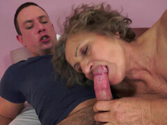 Horny mature is on a crusade to milk every young cock she can find