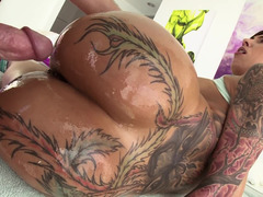 Big ass with hot tattoos is getting a dick pushes inside it