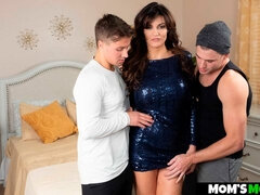 Beauty Becky Bandini is getting penetrated by two massive cocks